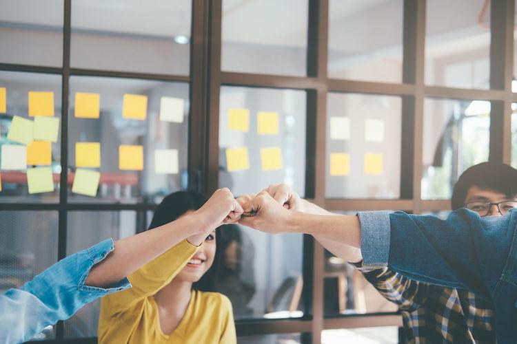 Business Entrepreneurs Celebrating Success At Office