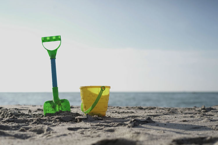 Sand shovel and castle shape bucket at the sandy beach.Kids toys to build sand castle.Copy Space. ASIA Children Family Holiday Kids Sand Castle Toys Beach Beach Day Child Family Time Island Kidsphotography Playing At The Beach Sand Sand Shovels Sandy Sandy Beach Shovel Summer Tropical