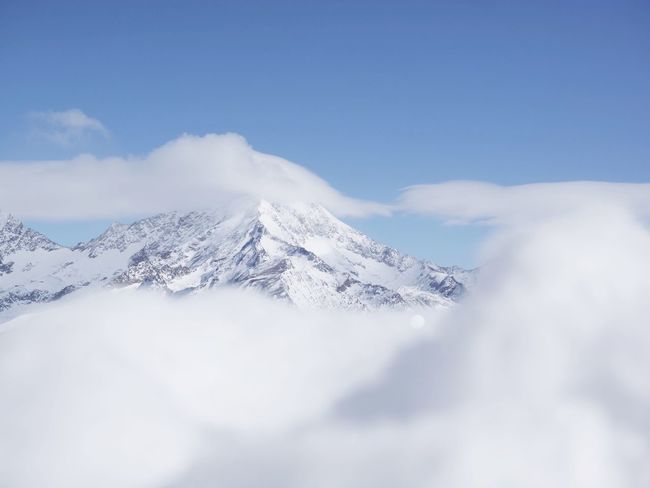Heavenly Swiss Alps Switzerland Beauty In Nature Nature Snow Cloud - Sky Scenics Tranquil Scene Sky Tranquility Mountain Winter Snowcapped Mountain Low Angle View Weather Landscape Day Cold Temperature Outdoors Blue Go Higher
