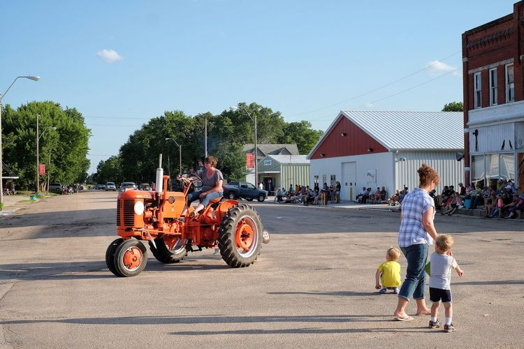 Parade 2016 Old Settlers Picnic Village of Western, Nebraska A Day In The Life Celebration Community Farmer Full Length Girl Power Lady Leisure Activity Lifestyles Main Street Main Street USA Mixed Age Range Mode Of Transport Old Settlers Picnic Parade Photo Essay Rural America Small Town America Small Town Life Small Town Stories Small Town USA Storytelling The Way Forward Tractor Western Nebraska