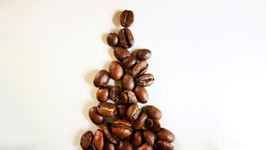 The Christmas Coffee Bean Brown Close-up Coffee - Drink Coffee Bean Coffee Cup Food Food And Drink Freshness Group Of Objects Indoors  Large Group Of Objects No People Raw Coffee Bean Roasted Roasted Coffee Bean Still Life Studio Shot White Background