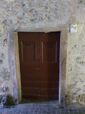 Doors Limone Limone Sul Garda Architecture Building Building Exterior Built Structure Closed Day Door Entrance House Metal No People Old Outdoors Protection Residential District Safety Security Wall Wall - Building Feature Window