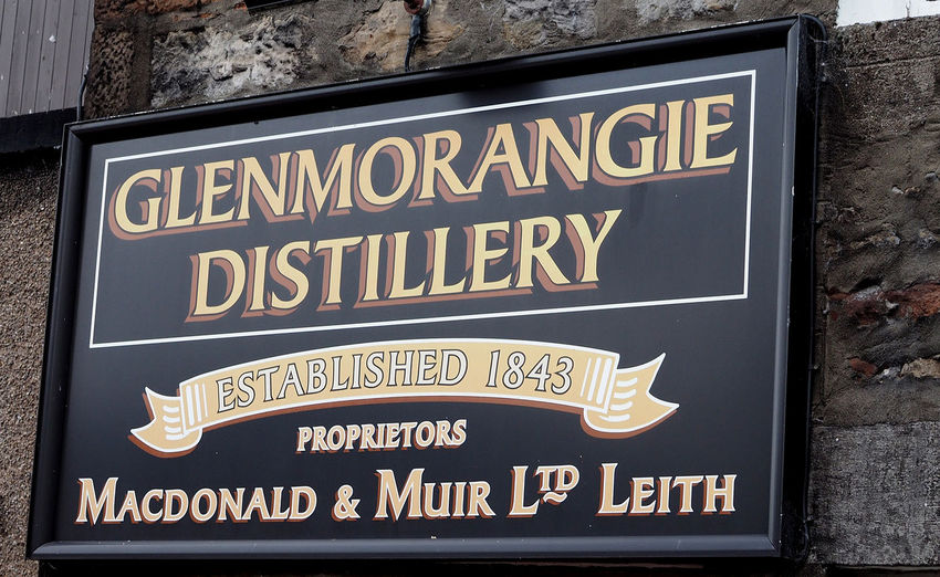 The Glenmorangie distillery who some think produce the finest single malt whisky in Scotland - near Invergordon, Highlands of Scotland Day Outdoors Direction Text Communication Close-up Guidance Glenmorangie No People Invergordon Single Malt Whisky Western Script Open Sign Company Sign Glenmorangie Distillery Scottish Highlands, Scotland, Highlands, Oban, Isles, Colour, Sea, Rocky, Rugged, Slate, Crashing Waves, Surf, Sky, Cloud, Remote, Great Britain, Natural Beauty, Landscape, Seascape, Waves