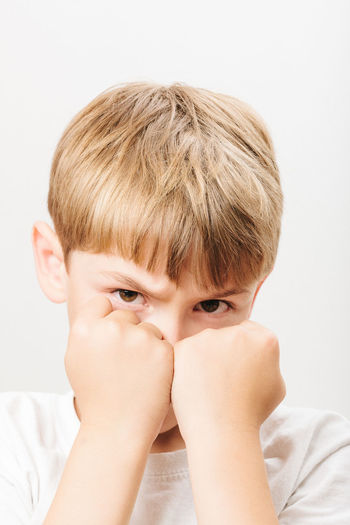 Boxing Fight Anger Blond Hair Boys Bully Child Childhood Close-up Day Defense Fists Hiding Indoors  One Boy Only One Person People Pose Real People White Background