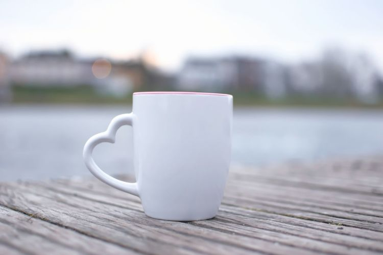 Cheers ☕ Coffee Cup Heart Shape Sunset Lake City Lifestyles Hello World Nature Germany Enjoying Life Still Life Relaxing Landscape Hanging Out Tranquility Summer Outdoors Quiet Moments Focus On Foreground EyeEm Nature Lover Day EyeEm Best Shots Porcelain  Wood - Material Table Hot Drink Calm