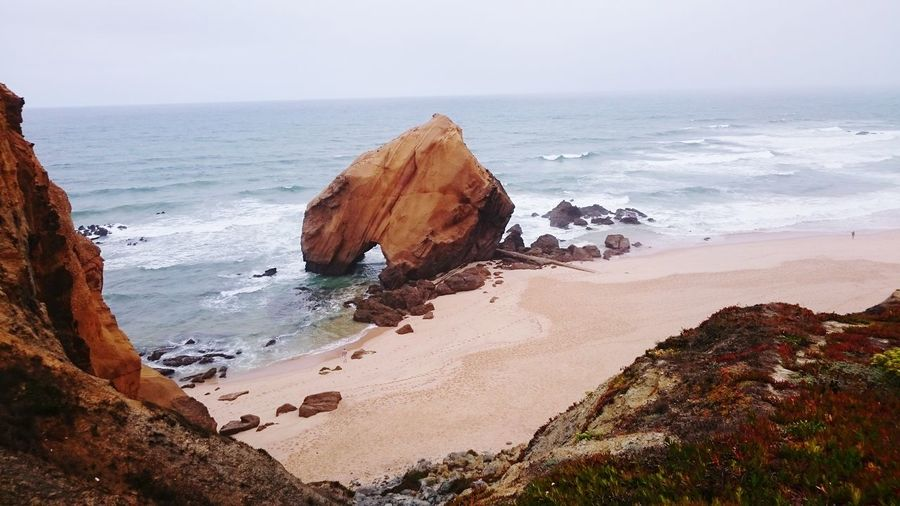 Penedo Do Guincho Sea Beach Sand Horizon Over Water Rock - Object Nature Tranquility Water No People Beauty In Nature Wave Day Travel Destinations Outdoors Landscape Sky