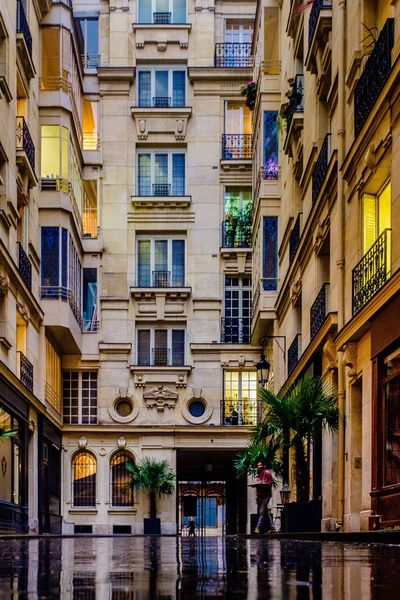 Stumbled into this little Parisian courtyard on a rainy day for shelter and thought how beautiful. Paris ParisByNight Paris In Winter Paris Streets ParisianLifestyle Courtyard  Lookingup Parisian Architecture Paris Architecture Haussmann Urbanlife Rainy Days Night Lights