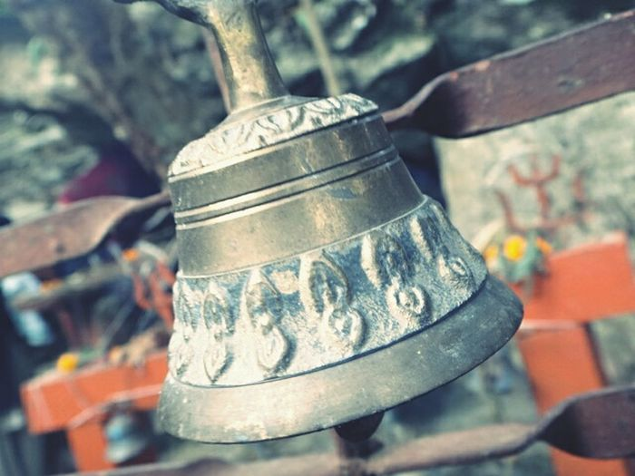 Holy bell.. Ancient Spirituality Place Of Worship Shiny Bell Close-up Religion Nepali Way Metalwork Metal Carving Art Holy Tradition Culture Respect Belief And Faith Ancestral Temple Ancestral Goddess Offerings Peace Love Outdoors Real Life Photography Life In The Mountains