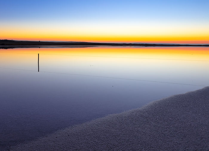 Water Sky Scenics - Nature Tranquility Salt Flat Horizon Orange Color No People Dawn Sunrise