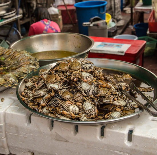 Crabs in plate for sale at market
