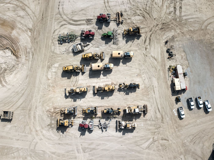 Tractors parked at a quarry High Angle View Day Architecture Industry Outdoors Transportation Aerial View Travel Destinations Construction Construction Equipment Earth Moving Machines Tractor Bulldozer Grading No People Overhead View Top Down View Parked
