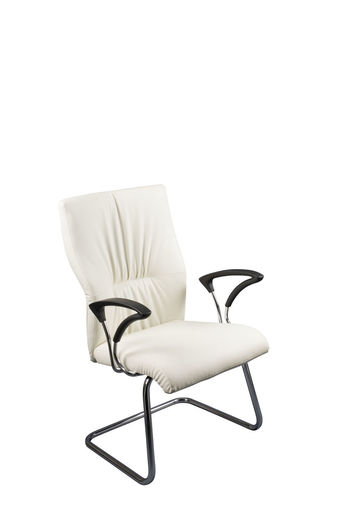 High angle view of empty chair against white background