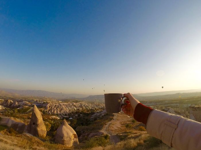 Balloons Cappadocia Cup Cup Of Coffee Flying Göreme Holding Holding A Cup Hot Air Balloon Hotairballoons Human Hand In My Hand Landscape Morning Mountains Nature Nature Outdoors Scenics Turkey