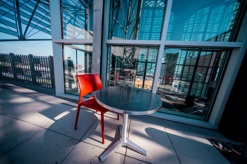 Chair Eating Remote Work Sitting Airport Airport Departure Area Architecture Building Exterior Built Structure Chair City Day Dine Empty Indoors  Modern No People Remote Working Seat Table Waiting Room Window Work Remote