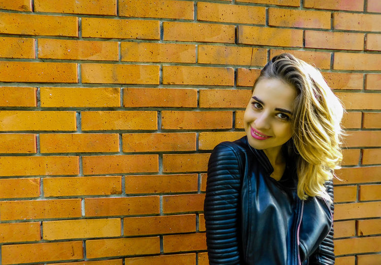 Posing in front of a brick wall Blonde EyeEmNewHere Standing Adult Attitude Beautiful Woman Black Jacket Blond Hair Brick Wall Day Daylight Fashion Girl Jacket Model One Person One Young Woman Only Outdoors People Posing Wall - Building Feature Young Adult Young Women
