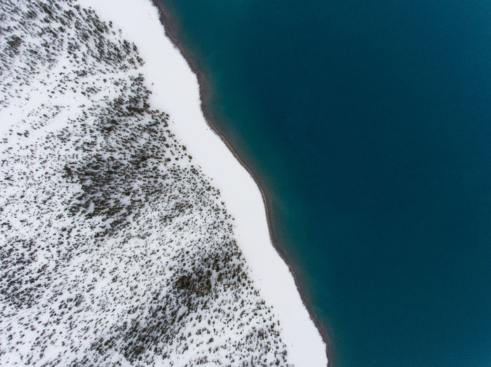 Icy Shoreline Aerial Photography Aerial Shot Aerial View Beauty In Nature Cold Temperature Drone  Mountain Nature Outdoors Sea Snow Tranquil Scene Water Winter