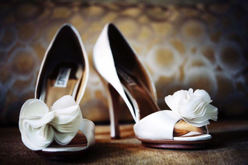 Close-Up Of Wedding Stilettos On Floor