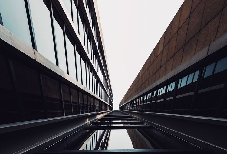 - A = ARCHITECTURE - Check This Out New Look ! EyeEm Best Edits Architecture_collection Office Building Architecture Architecture Built Structure Transportation Sky Clear Sky Building Exterior No People Diminishing Perspective Direction City Day Outdoors