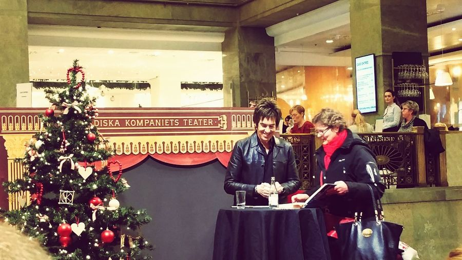 Per Gessle signing his book NK Per Gessle Gessle Indoors  Arts Culture And Entertainment Christmas Men Built Structure Real People Architecture