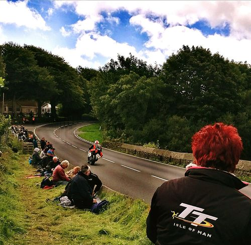 People And Places Large Group Of People Grass Cloud - Sky Lifestyles Leisure Activity Land Vehicle Vacations Person Green Color Togetherness Day Tree Sky Relaxation Motorcycles Memories Motorcycle Isle Of Man Mode Of Transport Road Racing Vibrant Color Incidental People Tourist Trophy My Favorite Place