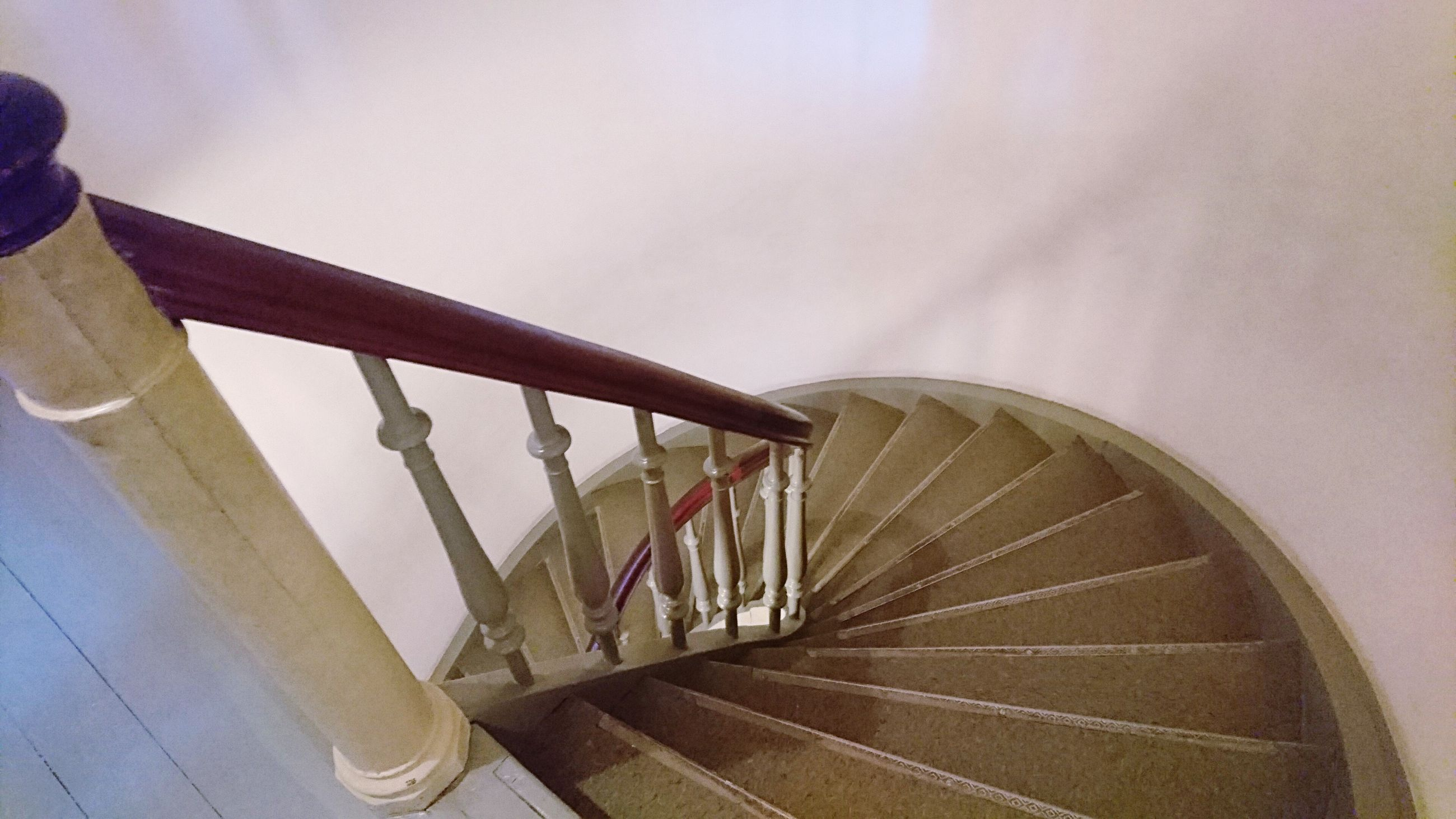 steps and staircases, staircase, steps, railing, spiral, stairs, spiral stairs, no people, architecture, built structure, hand rail, low angle view, indoors, spiral staircase, sky, day