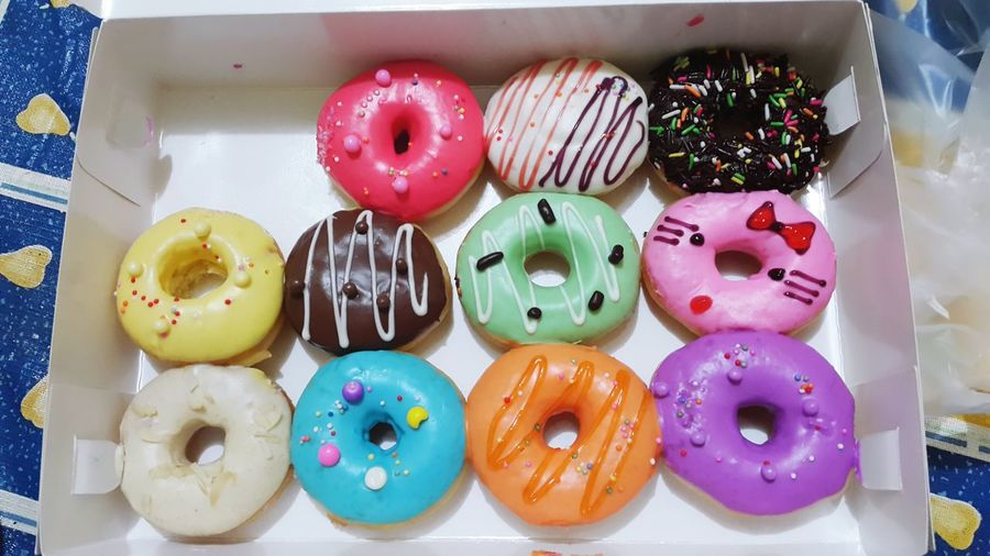Directly above shot of doughnuts in box