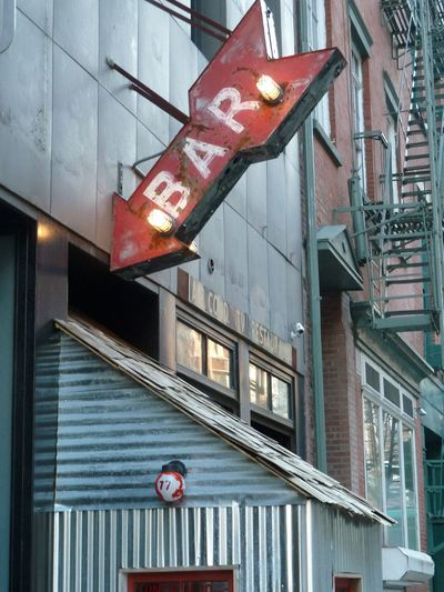 Arrow Symbol Bar Bar Sign Hanging Sign Industrial Landscapes New York City No People Red Pointing The Way Red Arrow Corrugated Iron Urban Fire Escape Stairs Neighborhood Map