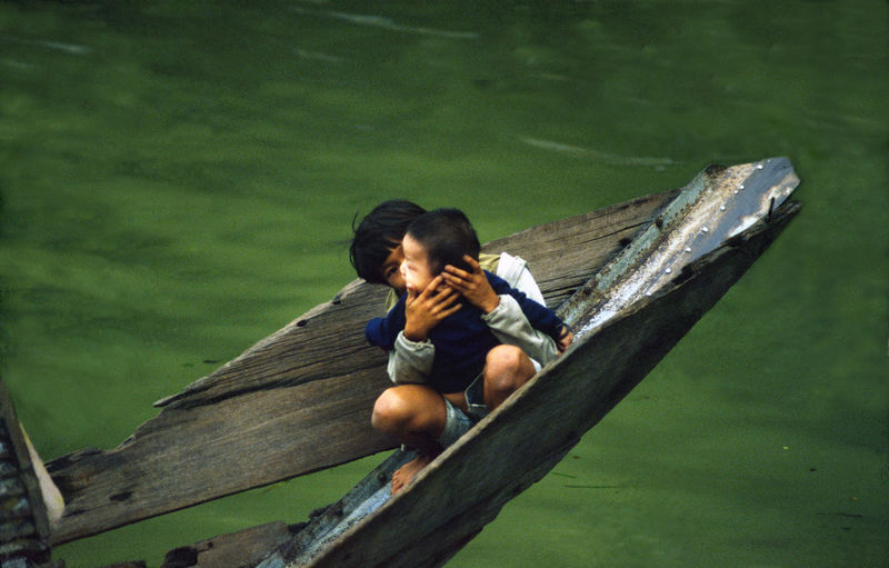 Boys Brothers Childhood Elementary Age Kids Kiss Lifestyle Nature Outdoors Protection Sitting Take Care Vietnam Wood - Material Young Adult Life In The River Hug Taking Care