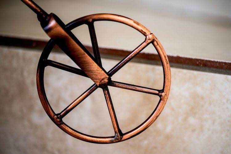 Cropped Image Of Toy Bicycle Wheel