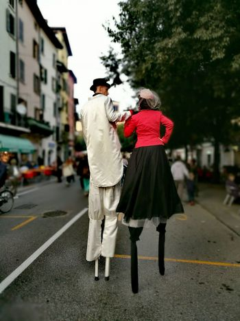 Street Full Length Road Rear View City Road Marking Car Person City Street Clear Sky Well-dressed Casual Clothing Building Exterior Focus On Foreground Outdoors City Life The Way Forward Holding Day Brescia Italy Italia Brescia, Italy Street Artist City Street
