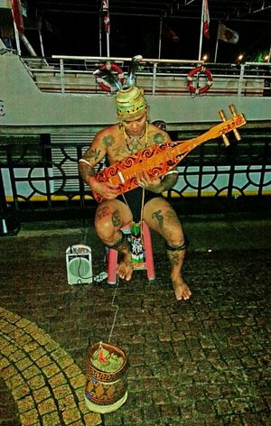 Streetphotography Streetperformer Tattoos Holiday Borneo Bodyart Classicalmusic Culture Musicinthepark My Country In A Photo
