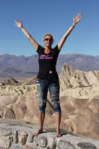 Dare to live your life in full color Full Length Real People One Person Front View Leisure Activity Happiness Nature Clear Sky Day Outdoors Arms Raised Standing Beauty In Nature Landscape Young Adult Death Valley Zabriskie Point Happy Miles Away