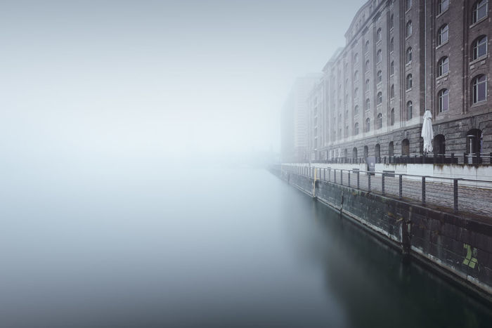 oberbaumbridge over foggy spree river in berlin against sky Architecture Beauty In Nature Berlin Building Exterior Built Structure City Day Fine Art Fog Foggy Friedrichshain Kreuzberg Long Exposure Modern Muted Colors Nature No People Oberbaumbrücke Outdoors Philipp Dase Sky Spree River Urban Geometry Discover Berlin Waterfront