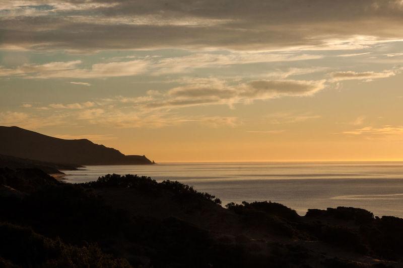 Beach Beauty In Nature Cloud - Sky Clouds Day Horizon Over Water Idyllic Landscape Nature No People Outdoors Sardegna Scenics Sea Stillness Sun Sunset Tranquil Scene