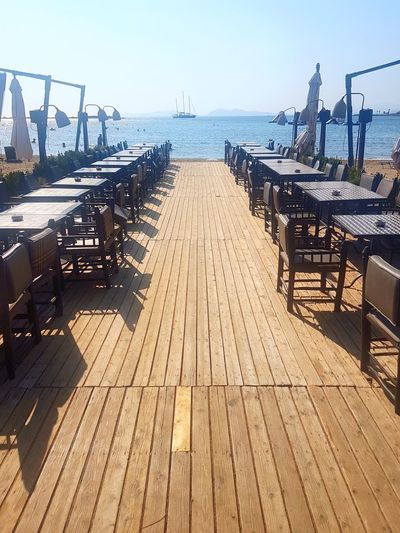 Glyfada Beach Restaurant Sand Sea And Sky Seating Planks Wood Scenery