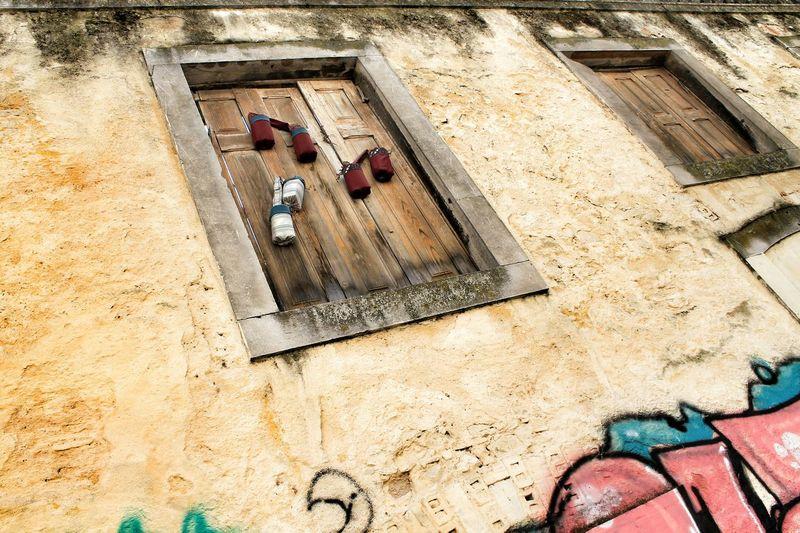 Closed until further noticeAbandoned Places Abandoned Architecture Graffiti Window Windows Windows And Doors Architecture_collection Urban Grunge GrungeStyle Lisboa Portugal Lisbona Portogallo Travel Travelingram Close Closed Intonaco Plaster Streetart Streetart/graffiti Spring Europe