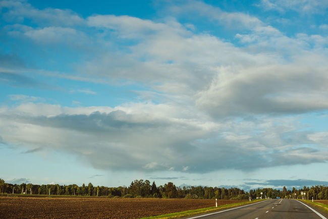 Empty Road Lietuva Traveling Agriculture Beauty In Nature Cloud - Sky Day Empty Road Field Landscape Nature No People Outdoors Road Rural Scene Scenics Sky The Way Forward Tranquil Scene Tranquility Transportation Tree