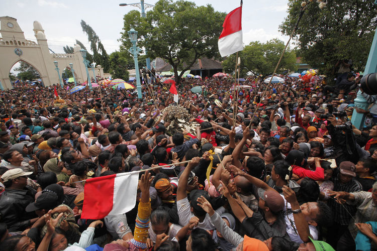 Crowd on street during ritual celebrations