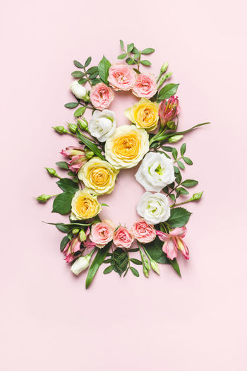 High angle view of rose bouquet against white background