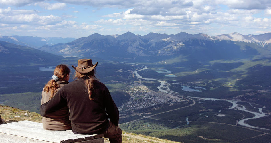 Tourists enjoy the panoramic view of the Jasper townsite and the canadian rockys from above the upper tram station. Jasper, Alberta, canada Mountain Mountain Range Real People Beauty In Nature Leisure Activity Nature Landscape Two People Rear View People Couple - Relationship Looking At View Positive Emotion Alberta Canada Jasper National Park Jasper View From Above Rocky Mountains Tourist Tourist Attraction  Tourist Destination Hikers Travel Canada Travel Destinations