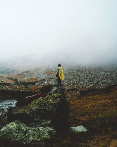 Lost In The Landscape Fog Real People Rear View One Person Nature Landscape Foggy Lifestyles Beauty In Nature Leisure Activity Full Length Day Rock - Object Mountain Hiking Men Standing Outdoors Scenics Adventure