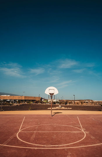 View of basketball court against blue sky