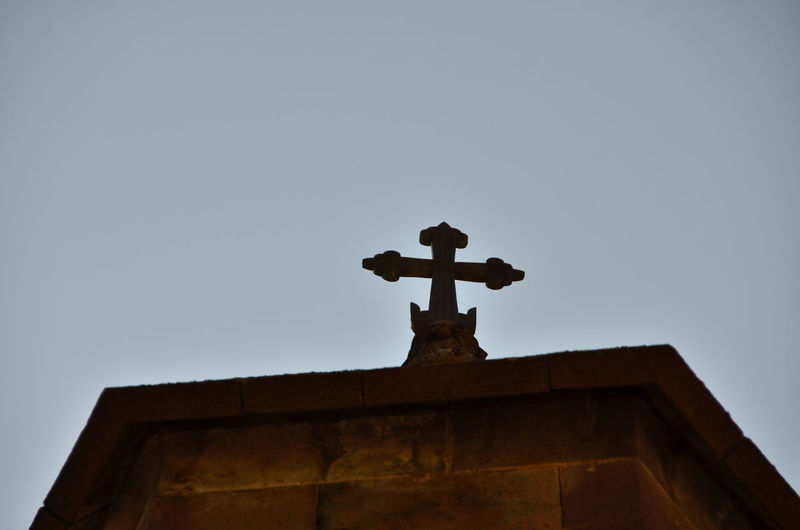 Armenia Geghard Geghard Monastery Architecture Building Exterior Built Structure Clear Sky Cross Day Low Angle View No People Oriental Orthodox Church Outdoors Place Of Worship Religion Sculpture Sky Spirituality Statue Travel Destinations W-armenien Weather Vane
