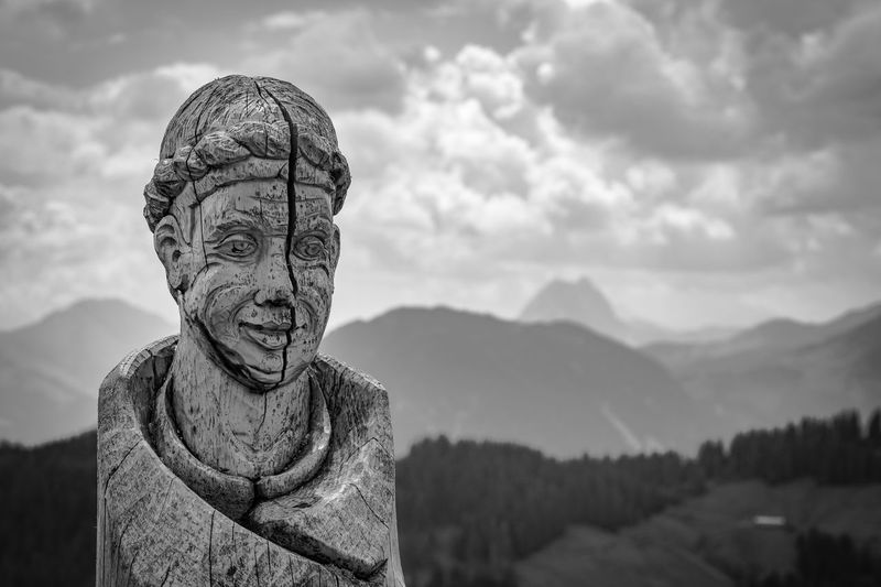 Art in the mountains Ellmau Wilder Kaiser Art Representation Sky Art And Craft Cloud - Sky Sculpture Mountain Statue Human Representation Male Likeness No People Creativity Beauty In Nature Tranquil Scene Craft Religion Spirituality Day Nature Scenics - Nature Belief Idol