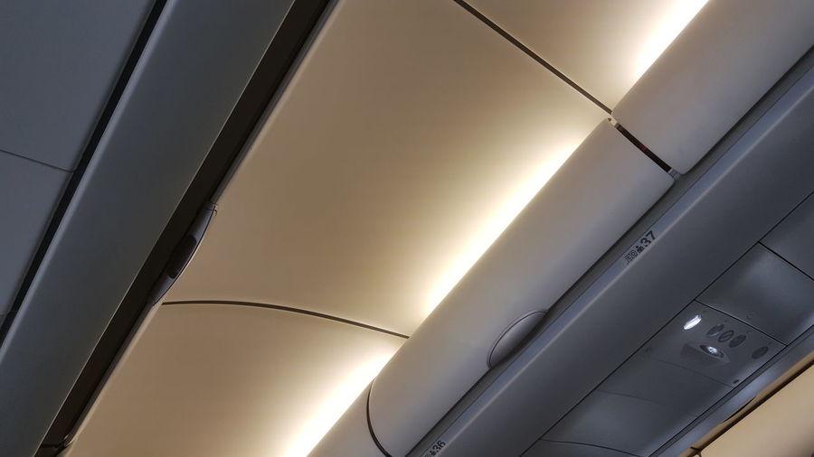 overhead baggage locker Underlight Dim Light Plane Aeroplane Airplane Airport Plane Air Hostess Steward Close-up Ceiling Airways