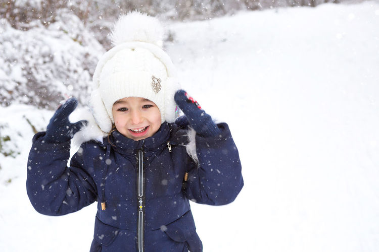 Portrait of smiling girl with snow covered face