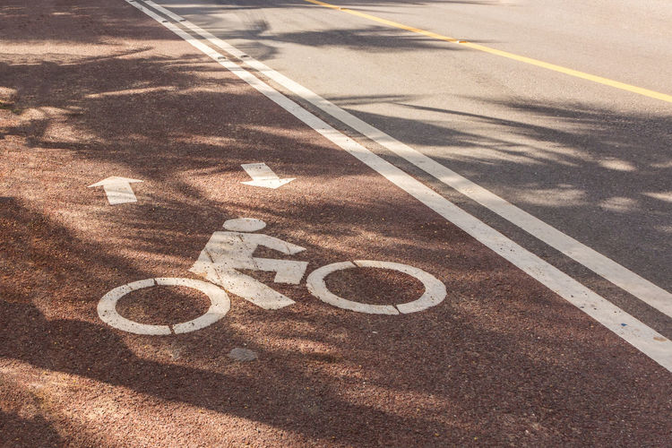 Bicycle Lane Communication Day No People Outdoors Road Road Sign Sunlight Transportation