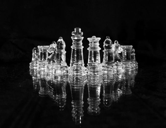 Reflection Black Background Studio Shot Game Board Game Indoors  Chess Strategy Glass - Material Chess Piece No People Leisure Games Close-up Relaxation Still Life Leisure Activity Symmetry Transparent Waterfront Challenge Digital Composite King - Chess Piece Pawn - Chess Piece Queen - Chess Piece Knight - Chess Piece