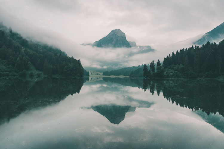 Cloudy and moody morning at the mountain lake Alps Cloud Cloudy Cloudy Morning Europe Fine Art Foggy Green Landscape Lovely Mood Mountain Nature Outdoors Peaceful Postcard Postcards Print Reflection Schweiz Suisse  Svizzera Swimming Swiss Alps Tranquility