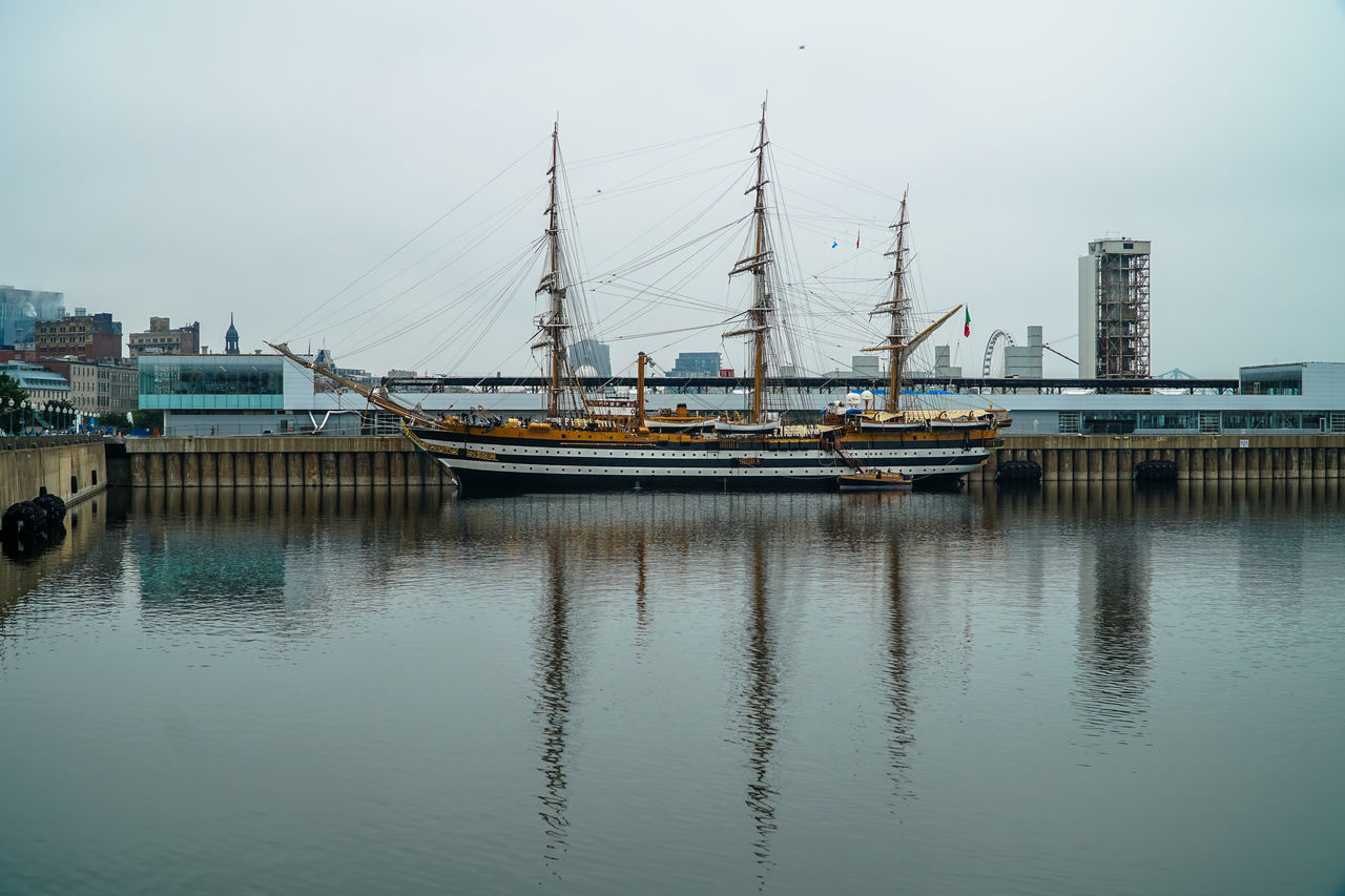transportation, nautical vessel, built structure, architecture, building exterior, water, no people, waterfront, outdoors, day, harbor, sky, moored, travel destinations, city, sea, mast, nature
